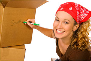 woman-packing-boxes-writing1209-300x200